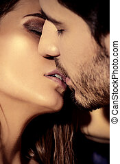 kissing lovers - Close-up portrait of a kissing passionate...