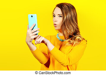 making selfie - Pretty young woman makes selfie on her...
