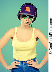 DJ girl - Modern young woman enjoys listening to music in...
