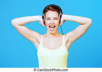 antistress - Modern girl enjoys listening to music in...