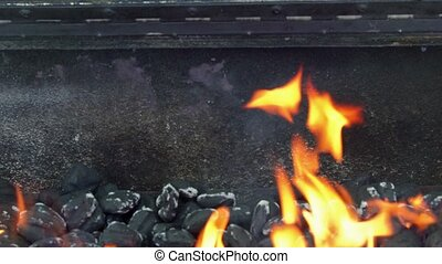 Glowing Hot Charcoal Briquettes Close-up Background Texture...