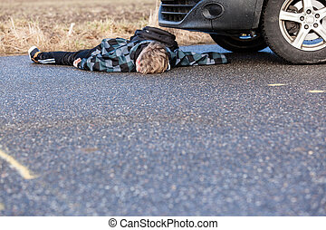 Young boy knocked down by a car