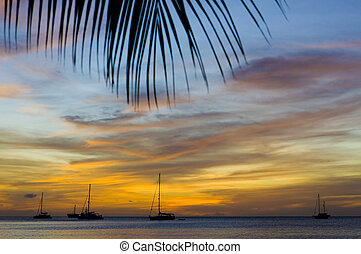 sunset over the Caribbean Sea; Grand Anse Bay; Grenada -...