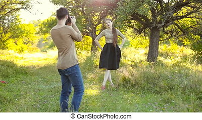 Woman photographing man - man photographs the girl on the...