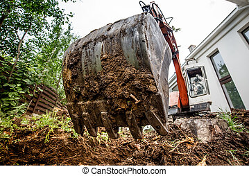 industrial heavy duty excavator digging at construction site...