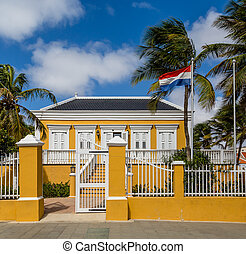 Yellow Government Building in Bonaire with flag