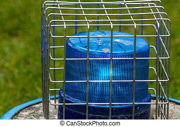 Blue flashing light in the wire cage - Blue flashing light,...