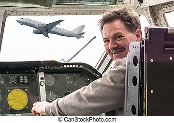 Man in aircraft cockpit. - Man in the cockpit. Looking over...