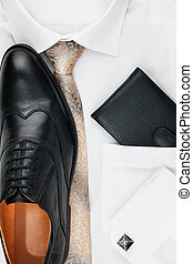 Mens classic accessories: shirt, tie, shoes, as a backdrop,...