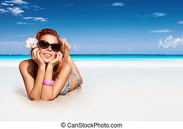 Nice girl on the beach - Nice girl relaxing on the beach,...