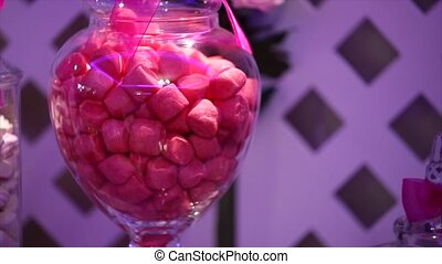 Candies in candy jar on wood table - Candies in candy jar on...