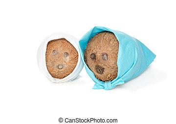 Two coconut in kerchiefs - Two coconut lying side by side in...