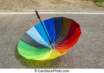 Inverted reversed umbrella on the road