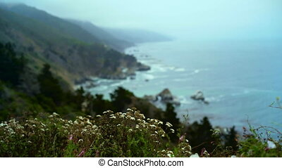 PCH Oceanside - Rack focus from the mountain vista on the...