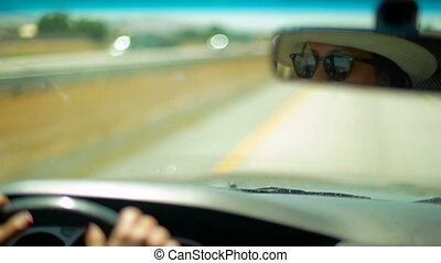 Summer Road Trip Driving - Female driver with hat and...