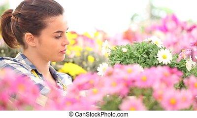springtime woman in garden - springtime woman smells the...