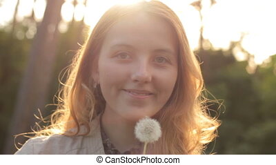 Young Woman Blowing Dandelion on the Nature - Beauty Young...