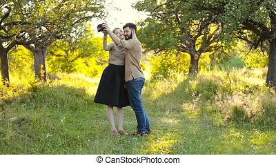 couple doing selfie camera on nature