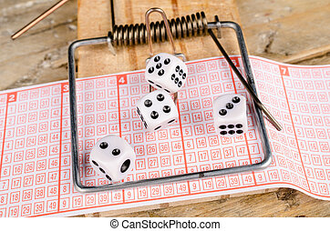 Compulsive gambling - Dice and lottery ticket in a...