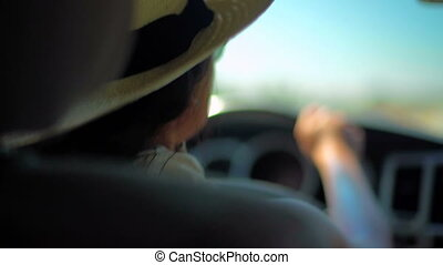 Summer Road Trip Driving with Music - Female driver with hat...