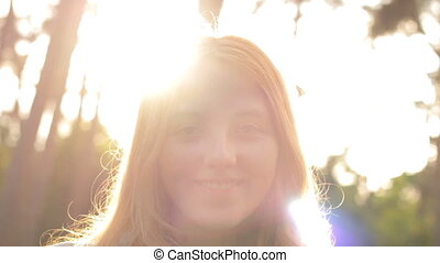 Young pretty girl smiling at camera - red-haired beautiful...