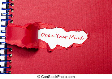 The word open your mind appearing behind torn paper