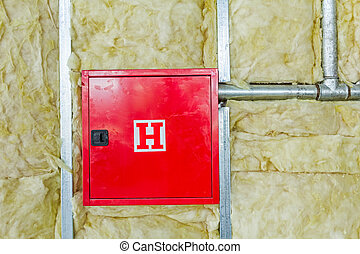 Red fire hydrant cabinet - Front side of fire box with...