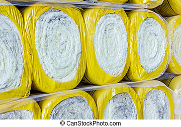 Stack of thermal insulation material in roll is wrapped with cellophane foil