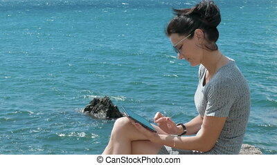 Woman Using Tablet PC - Young Woman Using Tablet PC On The...