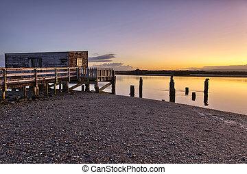 Boathouse at Okarito Lake - Boathouse at the shore of...