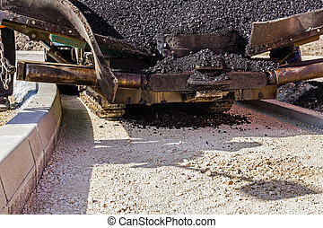 Tarmac road laying machine. Asphalt spreader - Front view on...