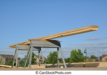 Boards on Sawhorses at Construction Site