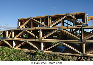 Stack of Floor Trusses for a House at Construction Site