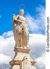 San Rafael Archangel statue in a sunny day and blue sky The...
