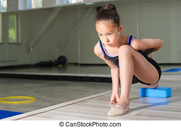 Girl doing gymnastics exercises