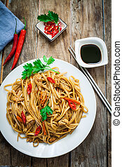 Chinese food on plate - Chicken chow mein a popular oriental...