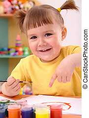 Child play with paints in preschool