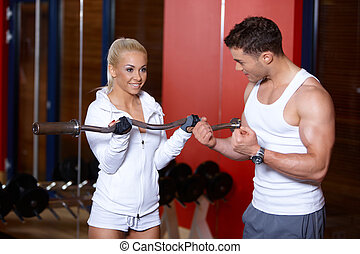 Couple at the gym - Sporty couple exercising at the gym