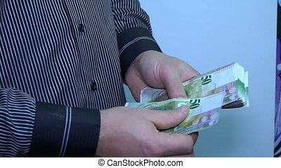 Unknown businessman counting money. The man pulled out a...