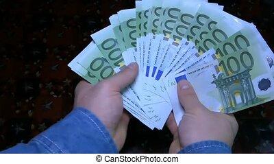 Money in human hands closeup.