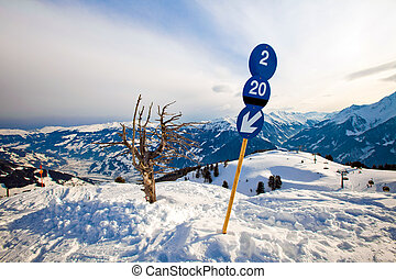 Blue route sign on the ski resort in Alps mountains in...