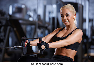 Woman at the gym - Beautiful woman exercising at the gym