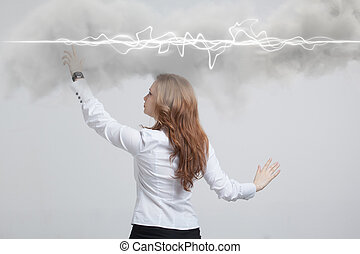 Woman making magic effect - flash lightning. The concept of...
