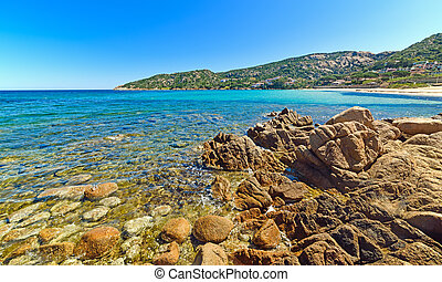 rocks and turquoise water in Cala Battistoni, Sardinia