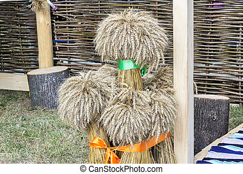 A few sheaves of wheat decorated with ribbons..