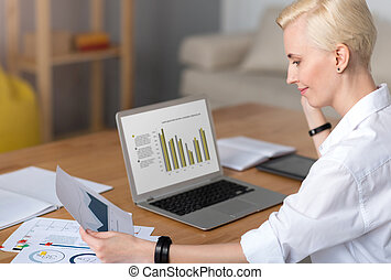 Woman working with diagrams at table - I have to work Woman...