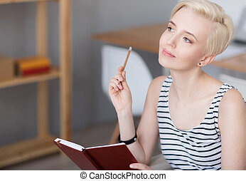 Woman thinking and holding diary - Power of mind Young...