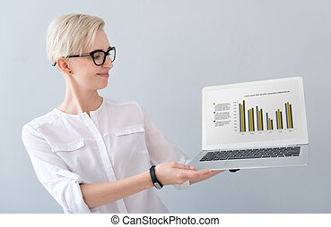 Woman presenting diagrams on laptop - Have a look Clever...