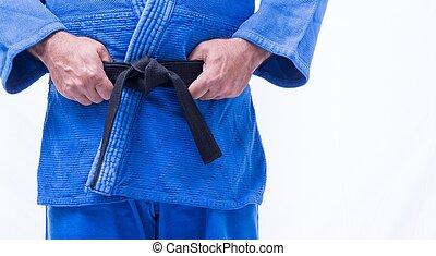 Close up of judo uniform, judo-gi, with belt isolated on...