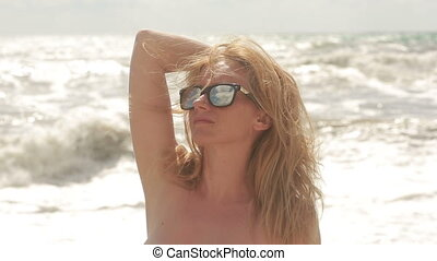 beautiful young woman in sunglasses. against the backdrop of...